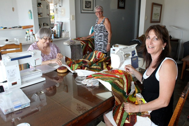 That's me in the black, making a quilt for an old RATG member who had been burnt out in a bushfire!